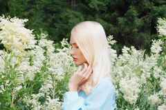Beautiful Blond young Woman with flowers Royalty Free Stock Image