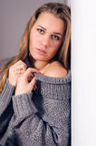 Beautiful blond young woman looking at camera in knitwear Stock Photos