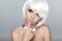 Beautiful blond young woman with polish finger. Makeup. Manicure Stock Photos