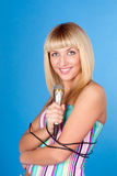 Beautiful blond young woman singing in microphone Stock Images