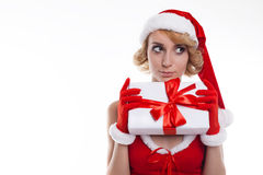 Beautiful blond young woman wearing Santa Claus costume holding Stock Images