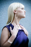 Beautiful Blonde 02. Beautiful woman displaying her new jewelry side Royalty Free Stock Images