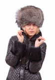 Beautiful blonde. Blonde in a fur hat on white background Royalty Free Stock Photo