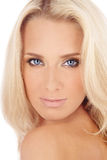 Beautiful blonde. Portrait of beautiful blond blue-eyed girl with golden makeup stock photos
