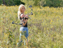 Beautiful blonde archer in field of wildflowers Stock Images
