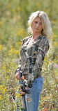 Beautiful blonde archer in field of wildflowers Stock Photos