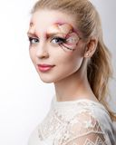 The beautiful blonde with artistic make-up Royalty Free Stock Photography