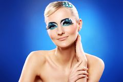 Beautiful blonde with artistic makeup Stock Photography