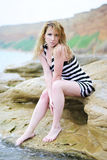 Beautiful blonde ashore epidemic deathes. One beautiful blonde ashore epidemic deathes Stock Photo