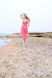 Beautiful blonde ashore epidemic deathes in rose gown. The beautiful blonde ashore epidemic deathes in rose gown Royalty Free Stock Photos