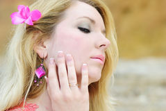 Beautiful blonde ashore epidemic deathes in rose gown Royalty Free Stock Images