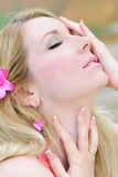 Beautiful blonde ashore epidemic deathes in rose gown Stock Image