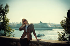 Beautiful blonde on the background of a cruise ship Royalty Free Stock Images