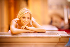 Beautiful blonde on balcony royalty free stock images