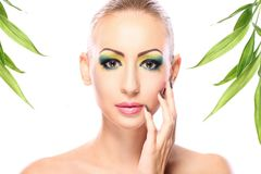 Beautiful blonde with bamboo leaves Stock Photo