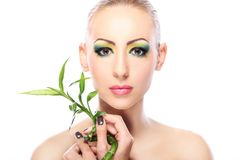 Beautiful blonde with bamboo leaves Stock Photography