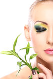 Beautiful blonde with bamboo leaves Royalty Free Stock Photos