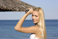 Beautiful blonde on a beach Stock Photo