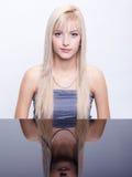 Beautiful blonde with beads Stock Photos