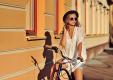 Beautiful blonde on a bicycle Royalty Free Stock Image