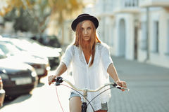 Beautiful blonde on a bicycle Royalty Free Stock Photo