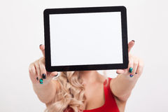 The beautiful blonde with big breasts standing on a white backgr Royalty Free Stock Photography