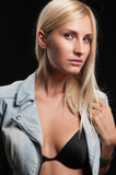 Beautiful blonde on a black background Stock Images