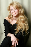 Beautiful blonde in black dress Royalty Free Stock Image