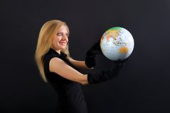 Beautiful blonde in black with globe Stock Images