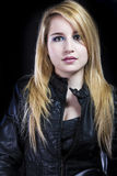 Beautiful blonde in black leather jacket Royalty Free Stock Image