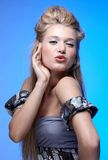 Beautiful blonde blowing kiss Stock Photo