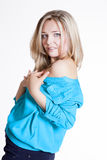Beautiful blonde in a blue blouse and trousers Stock Image