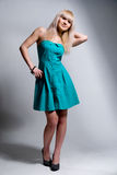 Beautiful blonde in a blue dress Royalty Free Stock Photo