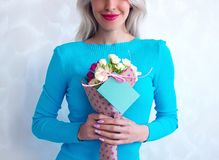 Woman with a bouquet of flowers Stock Photos
