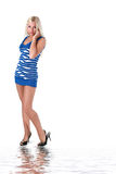 Beautiful blonde in blue stocking dress Royalty Free Stock Photography