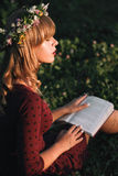 Beautiful blonde with book profile, copy space Stock Images