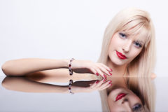 Beautiful blonde in bracelet Stock Images