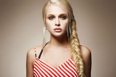 Beautiful blonde with braided hair Royalty Free Stock Photos