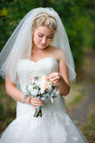 Beautiful blonde bride with bouquet Stock Photography