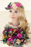 Beautiful Blonde Bride and Colorful Flower Arrangement Stock Images