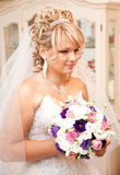 Beautiful blonde bride holding wedding bouquet Stock Photos