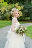 Beautiful blonde bride  in the Park whith wedding Stock Photography