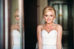 Beautiful blonde bride posing to photographer Stock Image