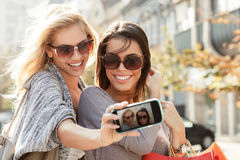 Beautiful blonde and brunette taking a selfie Stock Photography