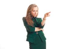Beautiful blonde business lady in green uniform pointing aside Stock Photography