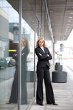 A beautiful blonde business woman. Standing outdoor the office Royalty Free Stock Images