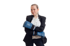 Beautiful blonde business woman in classic unifrom with blue boxing gloves smiling on camera Stock Photography