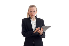 Beautiful blonde busniess woman in uniform with tablet in her hands looking at the camera Stock Photo