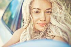 Beautiful blonde in car Stock Image