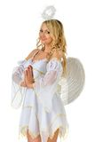 Beautiful blonde in carnival costume of angel. Royalty Free Stock Images
